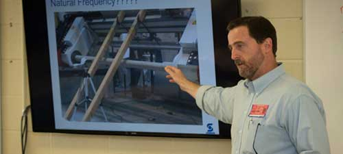 David Rhodes, Sonoco engineer, explains packaging machinery concepts to the ALO engineering class, 2014-15 school year