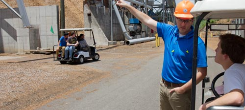 ALO engineering students ask key questions during a tour of Sonoco's biomass boiler facility
