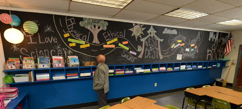 Dr. Comer looks at the Pathway board in Ms Adams' room