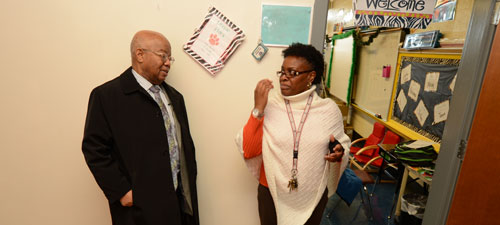 Washington Street principal Valerie Sawyer (right) welcomes Dr. Comer to the school