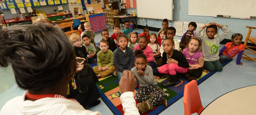 Kindergarteners answered questions from Dr. Comer