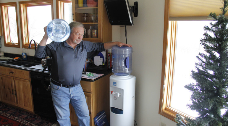 Nearly half the private wells in Wisconsin have tested unsafe: Frank Michna buys bottled water for drinking and cooking in his Caledonia home because of high levels of molybdenum and boron in his well. Cole Monka/WCIJ