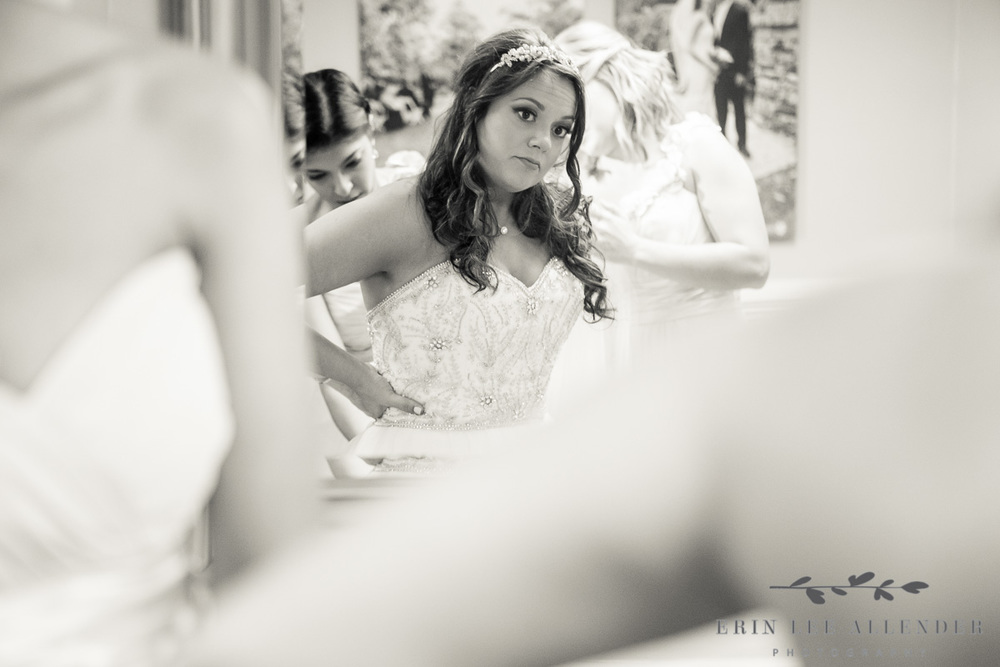 Bride_Looks_At_Herself_In_Mirror
