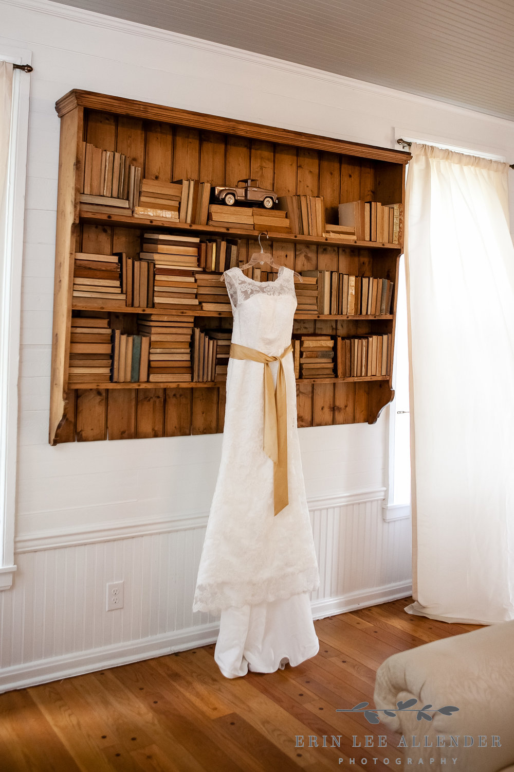 Wedding_Dress_Hanging_On_Book_Shelf