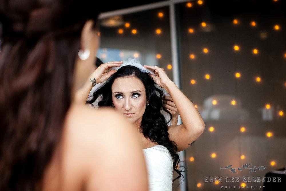Bride_Puts_On_Veil