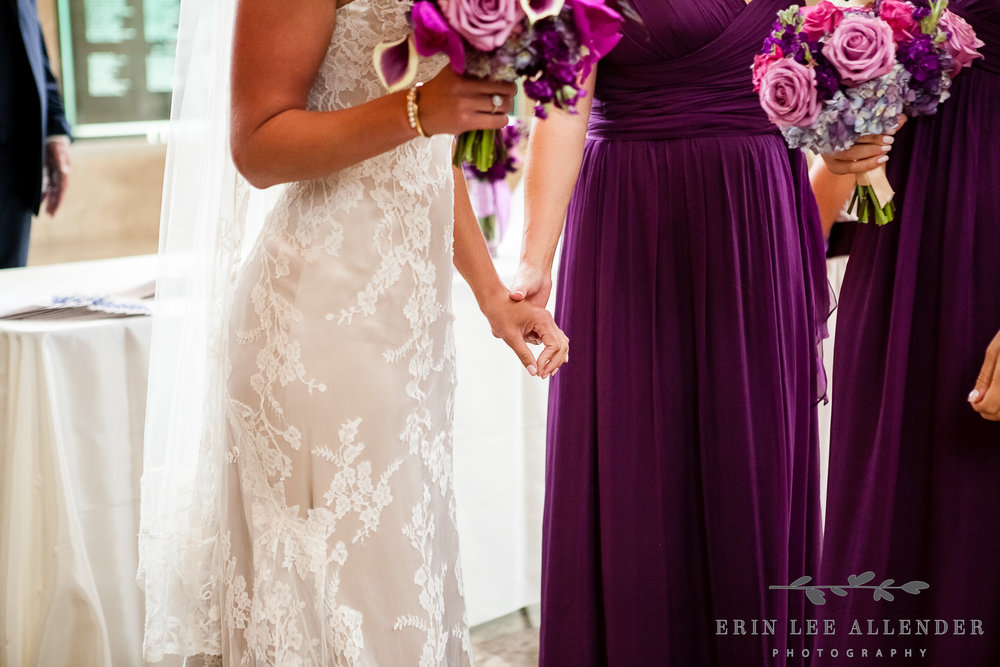 Bride_Squeezes_Maid_Of_Honors_Hand