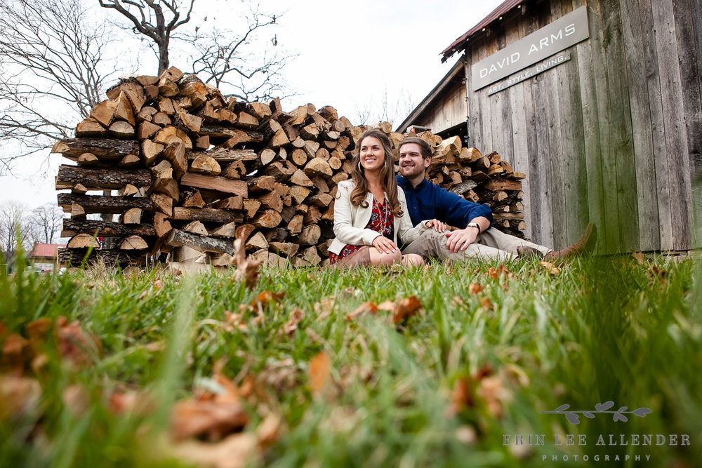 Couple_Sitting_By_Wood_Pile