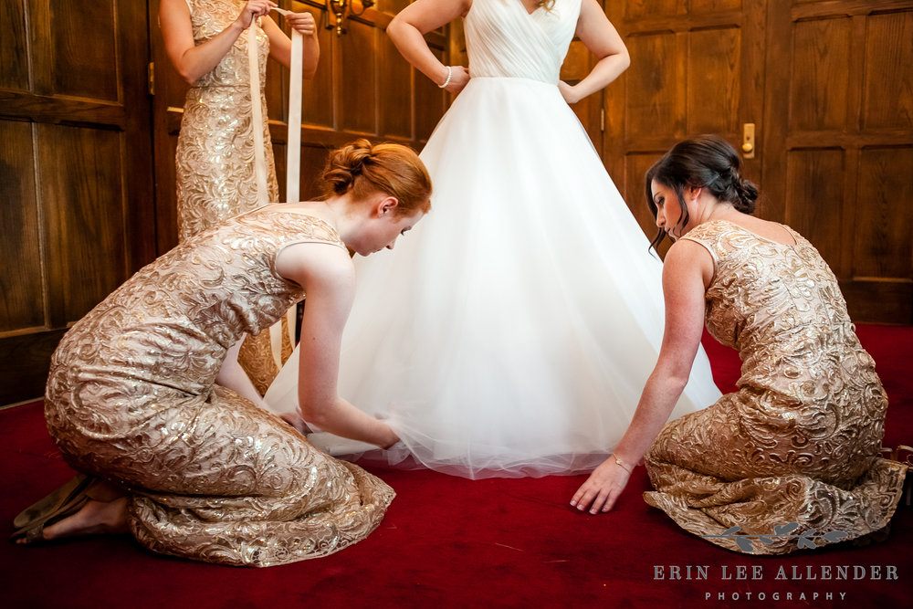 Bridesmaids_Help_Bride_Into_Wedding_Dress