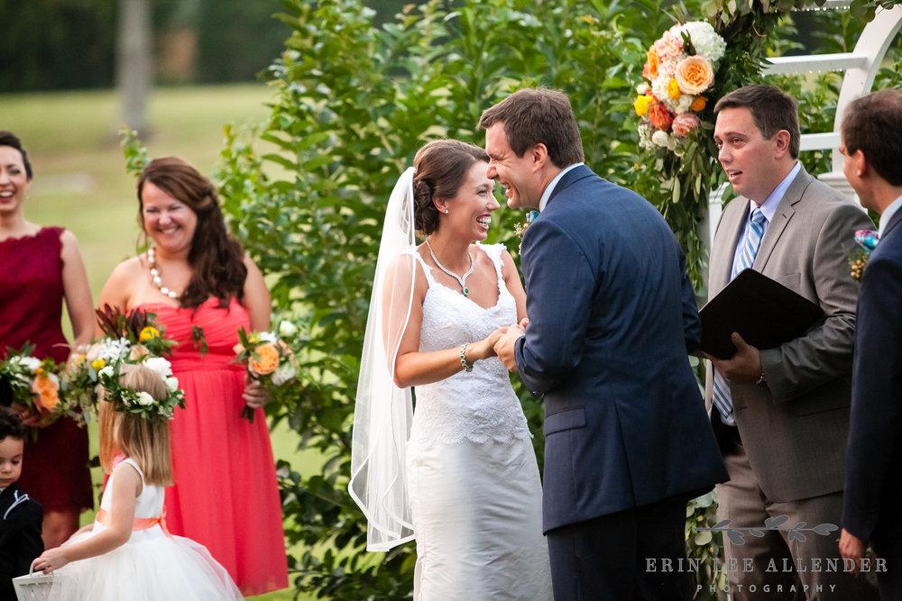 Bride_Groom_Laugh_At_Vows