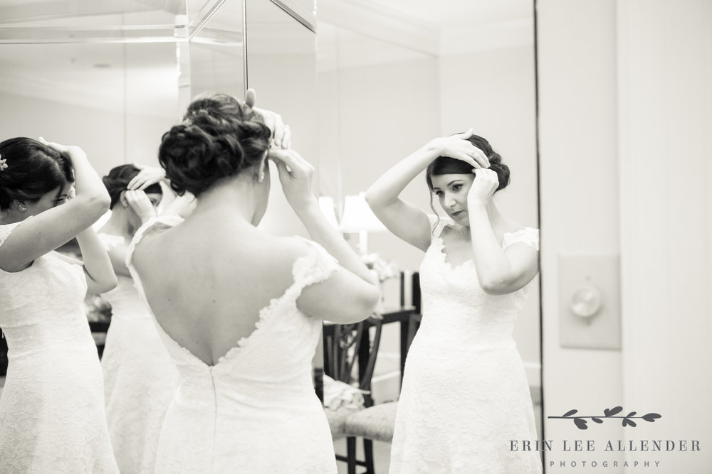 Bride_Fixing_Her_Hair_In_Mirror