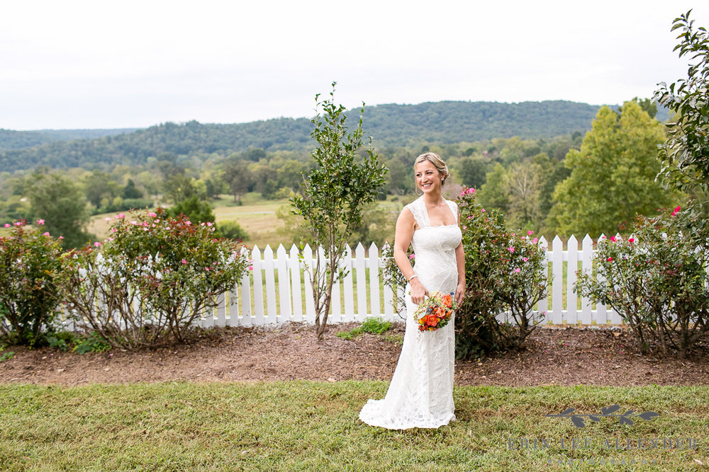 Bride_In_Front_Of_White_Picket_Fence