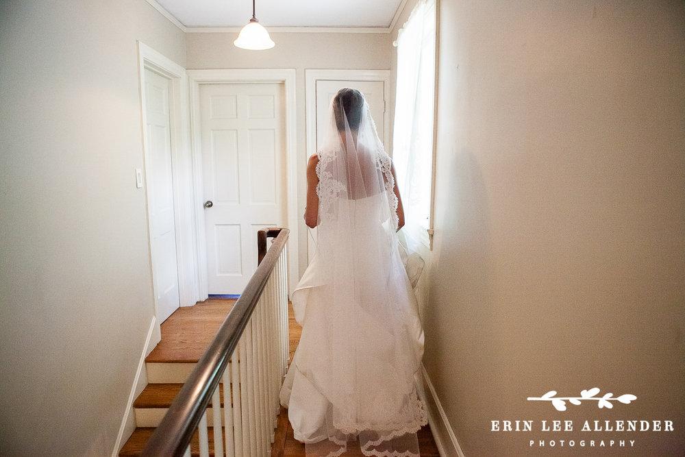 Bride_Walks_Through_Hallway