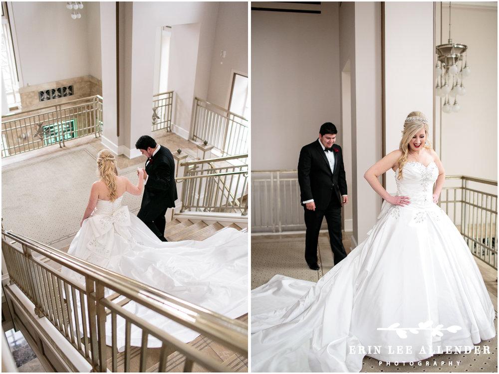 Groom_Looks_At_Brides_Dress