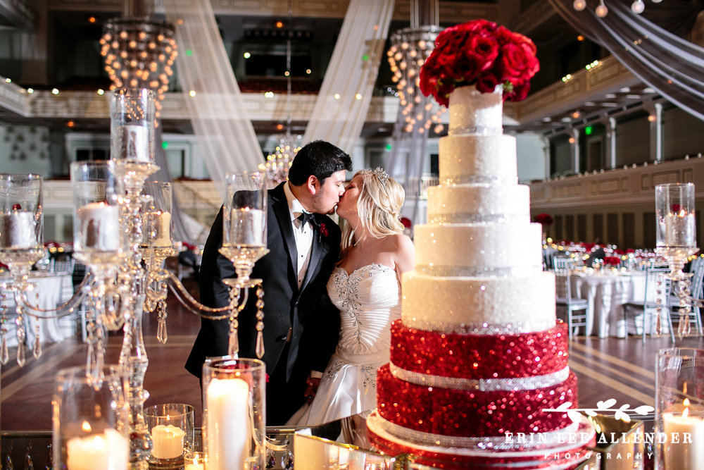 Bride_Groom_Kiss_By_Cake