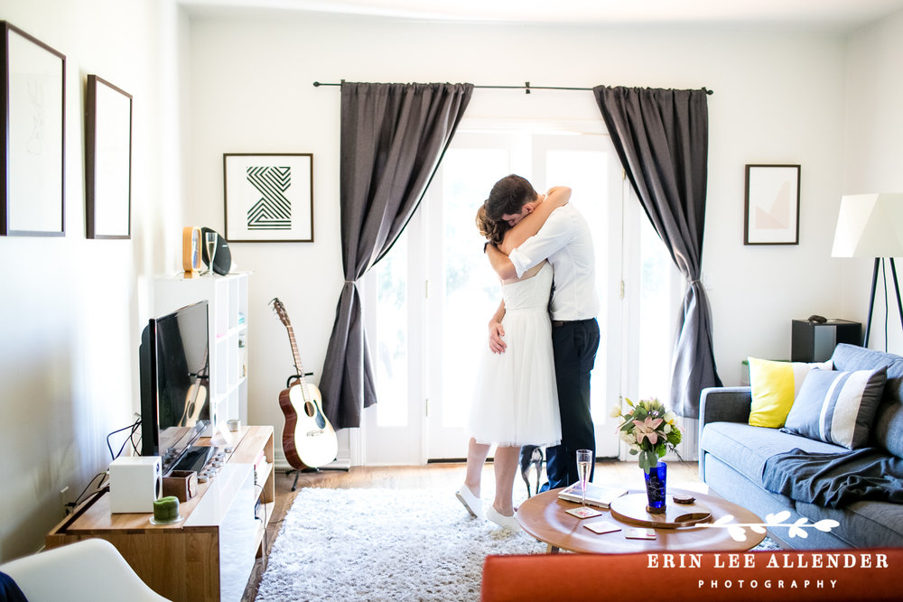 Bride_Groom_Hug_In_Living_Room