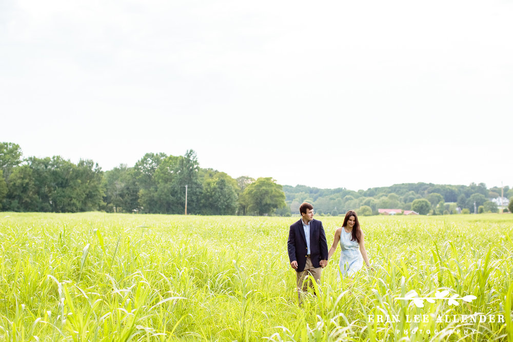 Couple_Walks_Through_Field