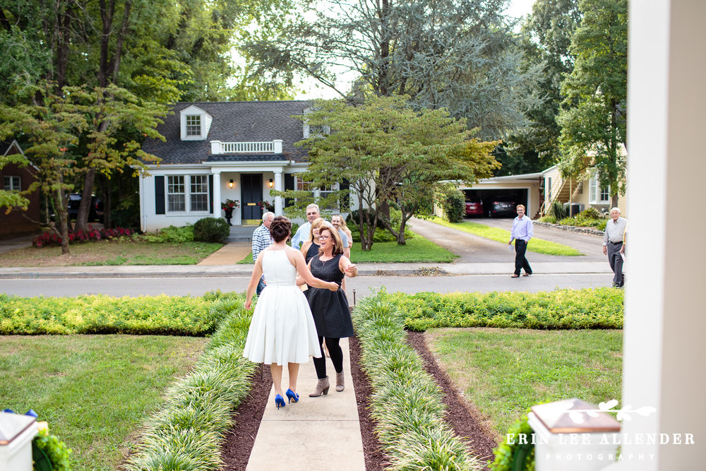 Bride_Greets_Guest_Backyard_Wedding