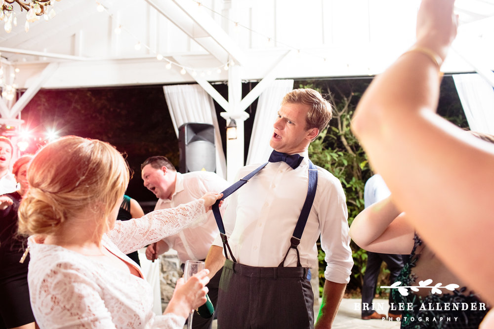 Bride_Pulls_Grooms_Suspenders