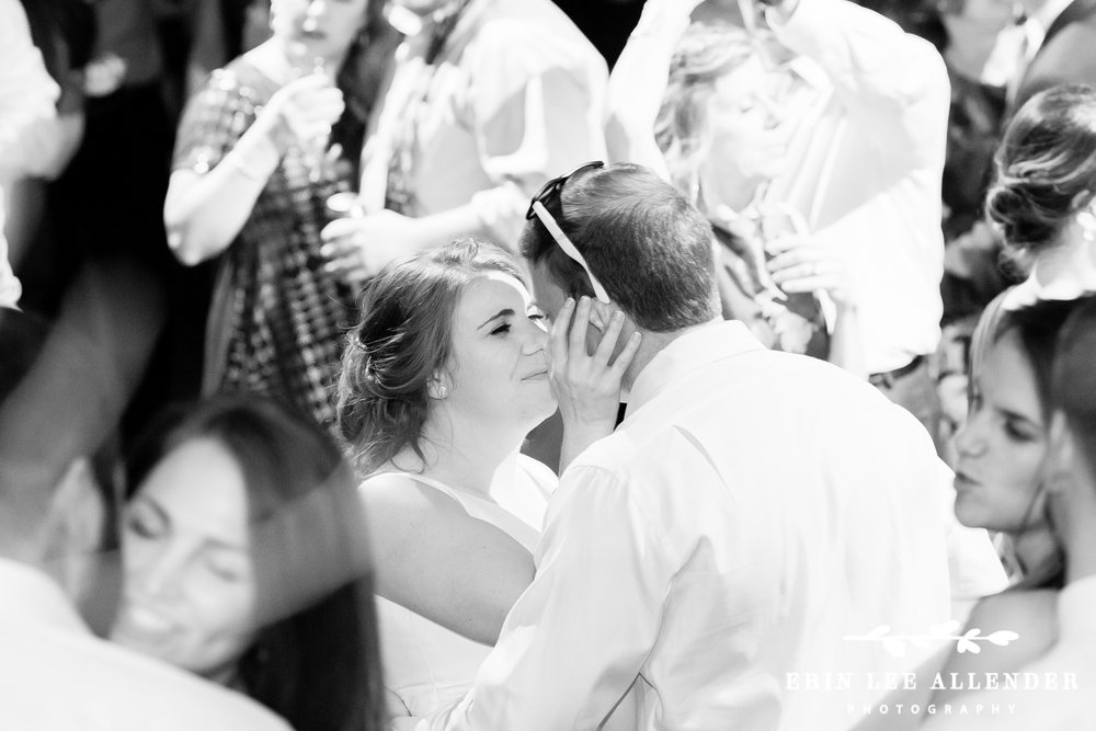 Bride_Kisses_Groom_On_Dance_floor