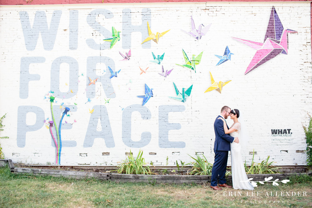 Bride_Groom_In_Front_Of_Mural