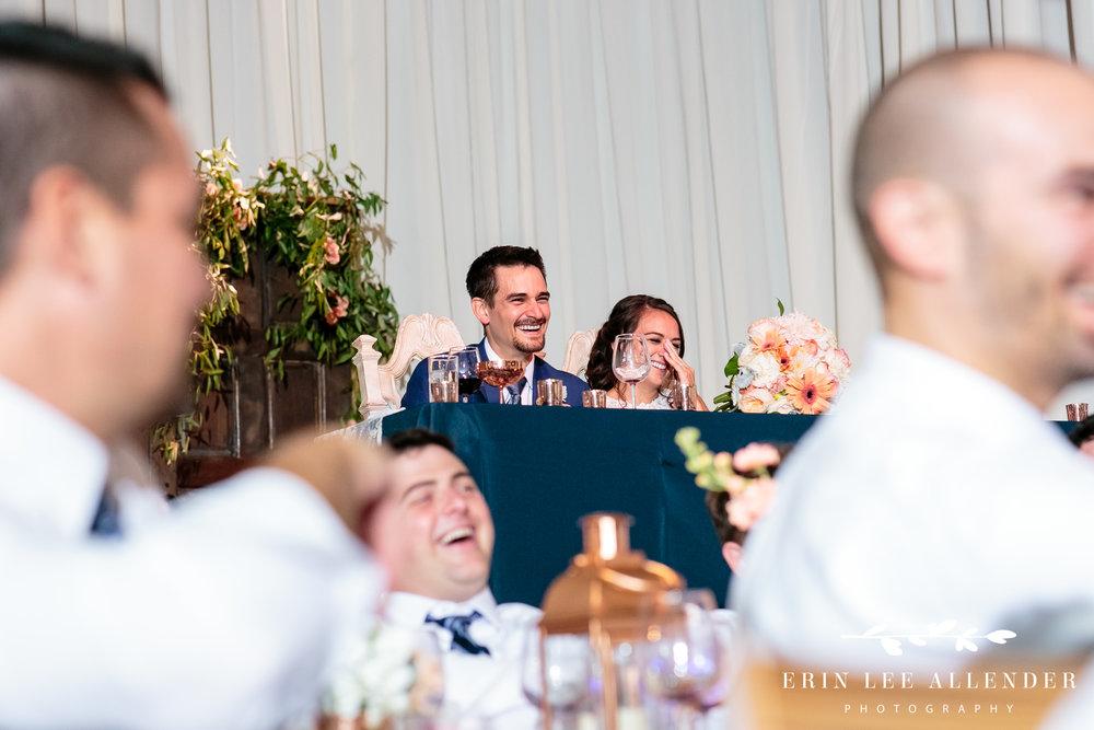 Bride-Groom-Laugh-at-toast
