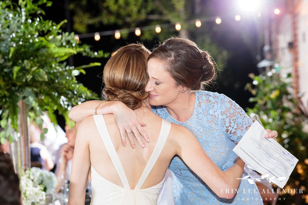 Bride-hugs-sister