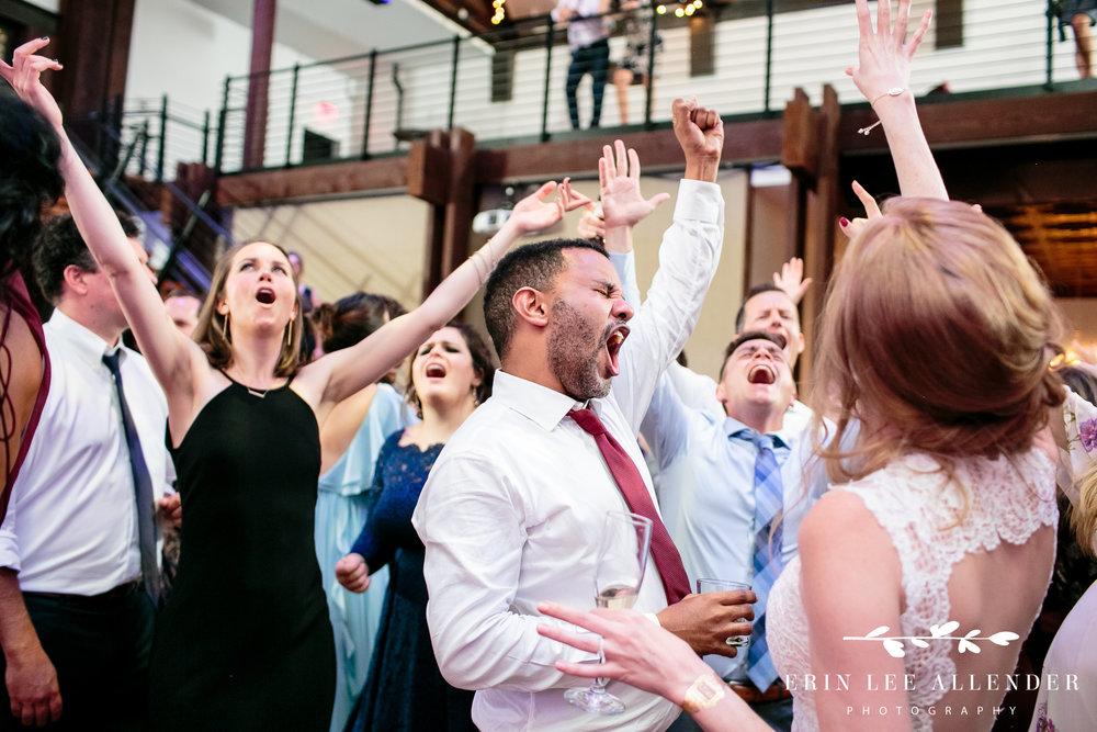 Groom-singing-reception