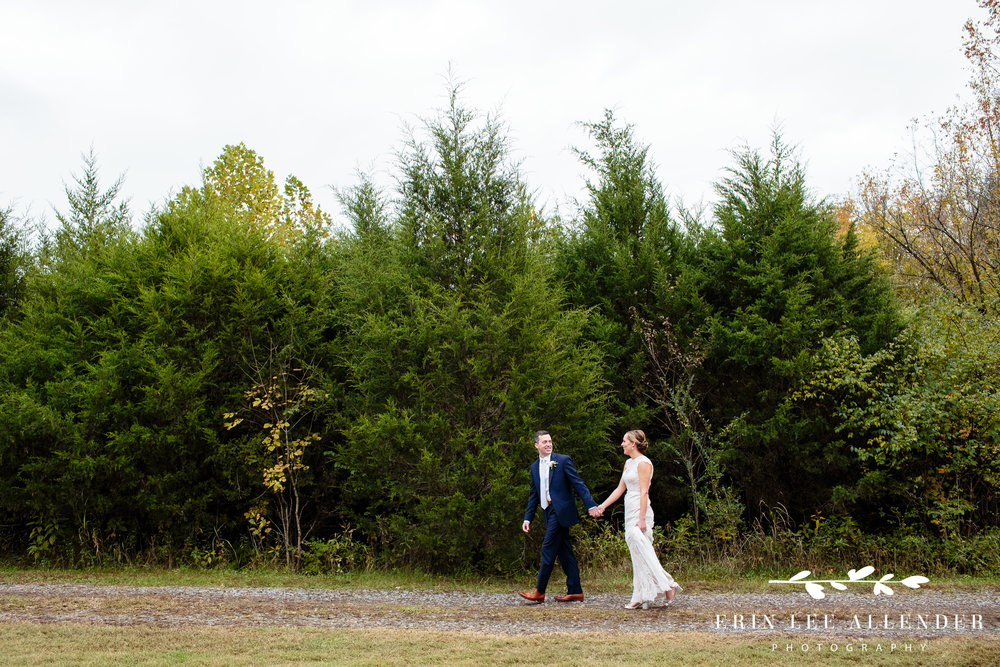 Couple-walking-pine-trees