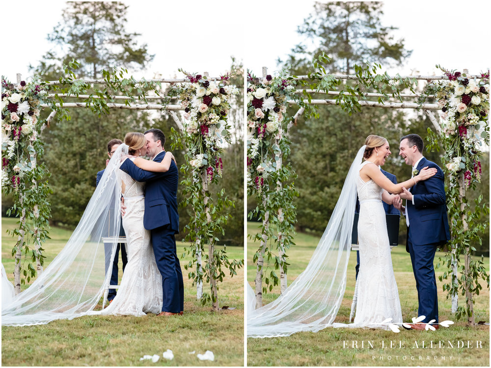 bride-groom-kiss-at-alter