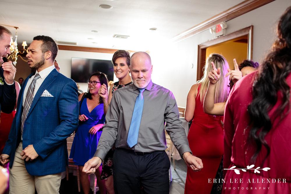 father-groom-dancing