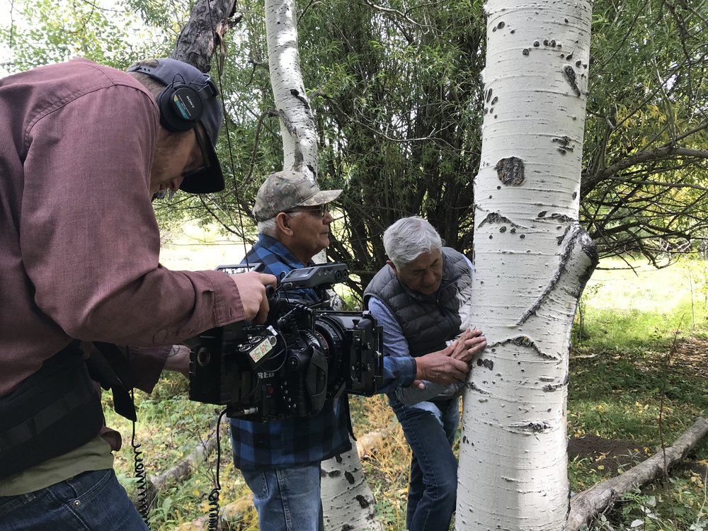 Director of Photography Bill Stengel films as Tito Naranjo shows his brother Michael bear claw marks on a tree.