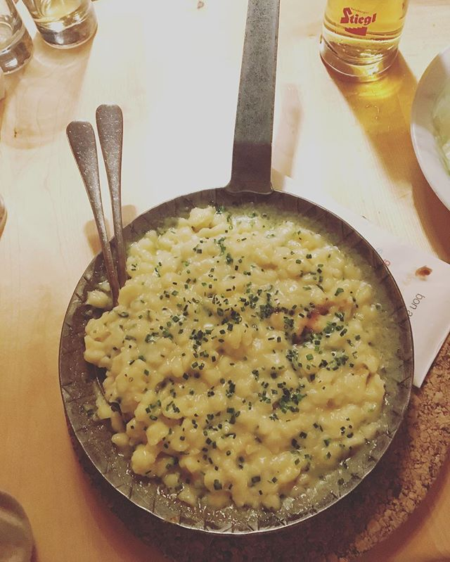Käsespätzle — the Austrian version of Mac and Cheese.  Best enjoyed with a Stiegl Bier after walking or skiing miles through the snow.  Made with homemade egg dumpling/noodles and tons of Emmentaler or Gruyere.  A lot of mountain huts, like this one, will even make their own cheese to go into this dish and Kaspressknödel.  #käse #käsespätzle #alpinekäse #alpinecheese #austrianfood #austrianfoodie #emmentaler #gruyere #lindlingalm #hinterglemm