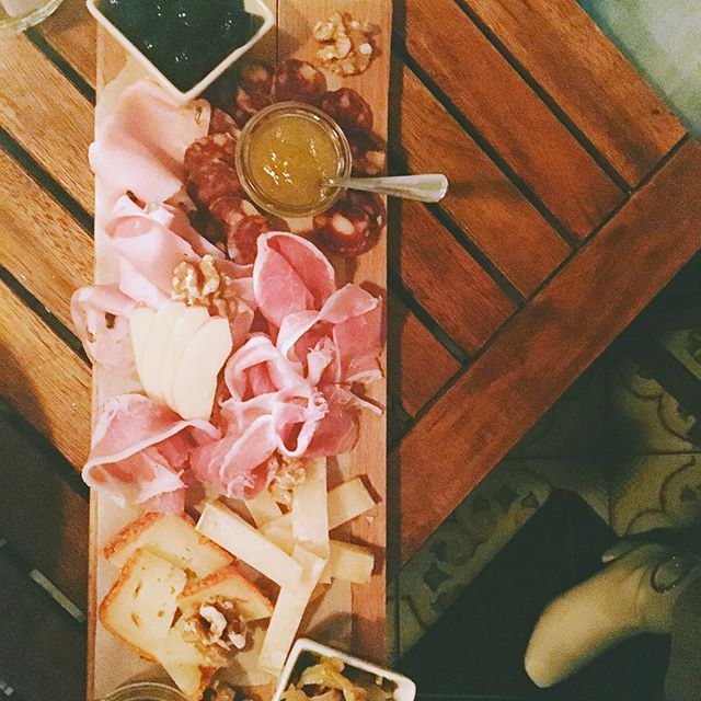 Charcuterie and a beautiful white boot.  So Berlin.  Favorite pairing off this board was the Pecorino washed in chiles, pickled eggplant, with a little drizzle of honey.  @la_premiata_ditta  #berlinfoodie #berlinfoodie #italianberlin #lapremiatta #berlinmitte #cheeseberlin #charcuterie #pecorino #cheesetravel