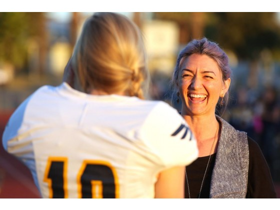 Rancho Christian's Emma Baker (19) takes a break from warmups to speak with Heidi Garrett Villa, whose 48-yard field goal is the national record for female kickers.