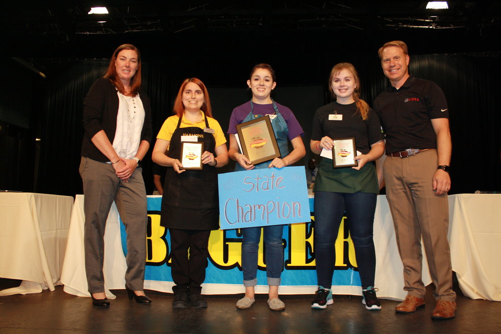 From left to right: Kate Bradshaw, Emcee; Janette Kalt, Harmons (2nd Place); Kaylee Hudson, Macey's (1st Place); Kaitlin Schaugaard, Fresh Market (3rd Place); Dave Davis, UFIA
