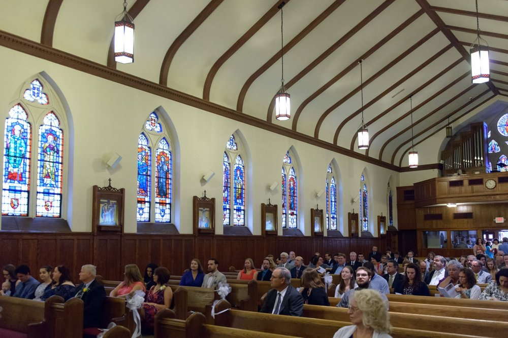 Guests at a wedding at St James Catholic Church in Falls Church, Virginia