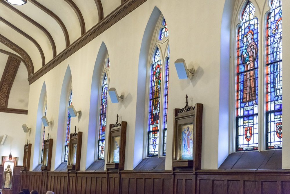 Stained glass windows at St James Catholic Church in Falls Church, Virginia