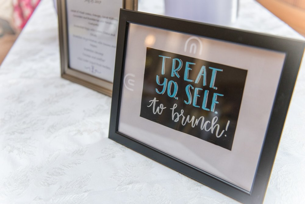 "Sign at a brunch wedding that says ""Treat Yo Self to brunch!"""