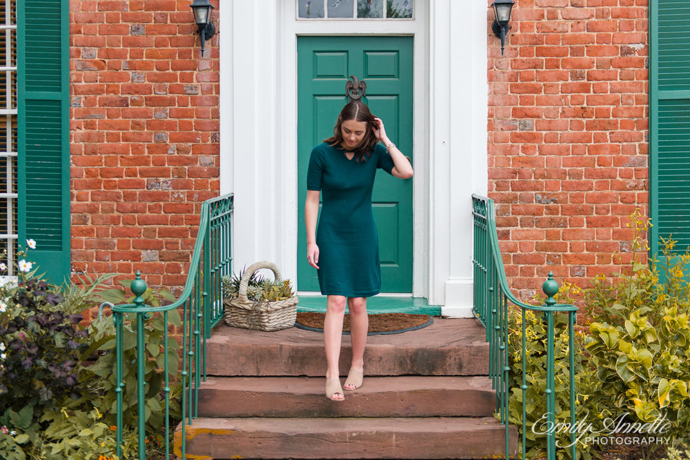 A young woman walks down the steps of a historic house in Green Spring Gardens in Fairfax, Virginia