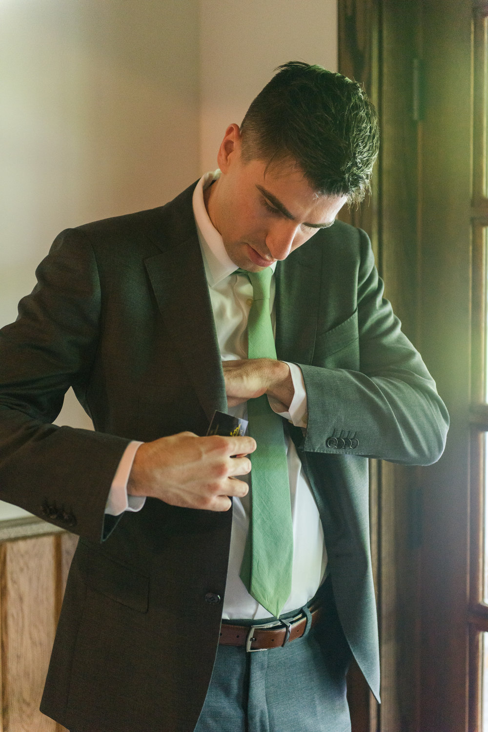 A groom gets ready for his wedding at Faithbrooke Barn and Vineyards in Luray, Virginia