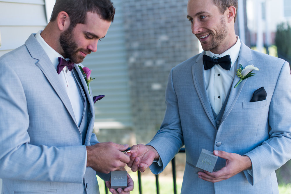 A groom hands off the rings to his best man before the wedding ceremony in fairfax, virginia