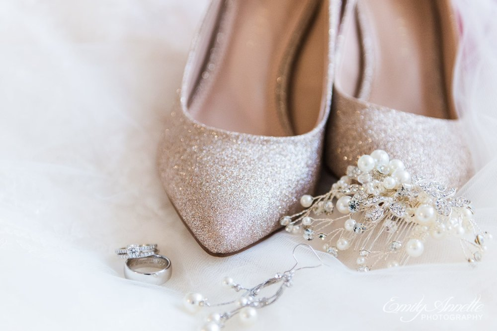 Sparkly bridal details with wedding rings, bridal comb, bridal wedding shoes, and lace before a wedding in Arlington, Virginia