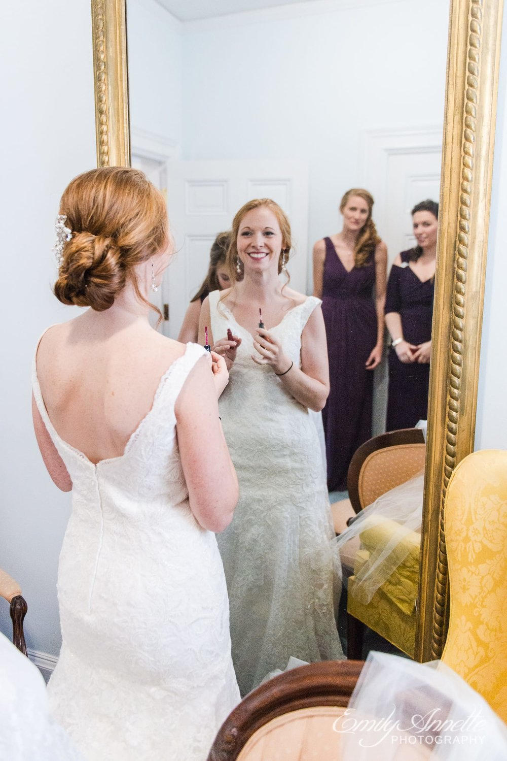 A bride getting ready in the bridal suite of the historic house before her Catholic wedding in Arlington, Virginia