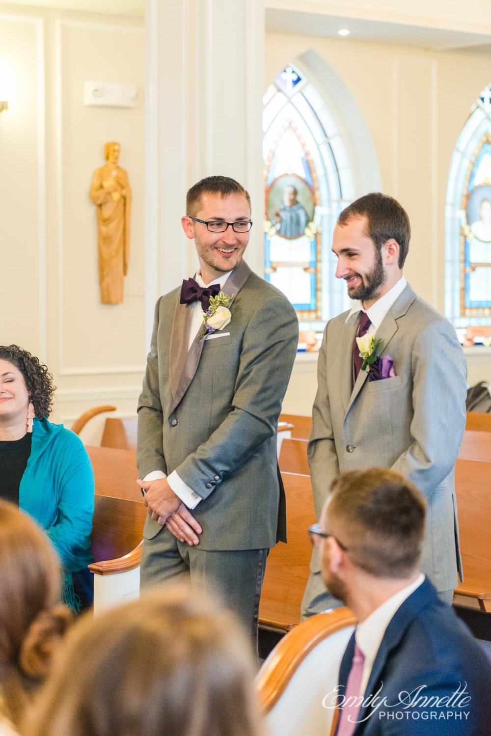 The groom and best man enter in procession during a Catholic wedding ceremony at Marymount University's Sacred Heart of Mary Chapel in Arlington, Virginia