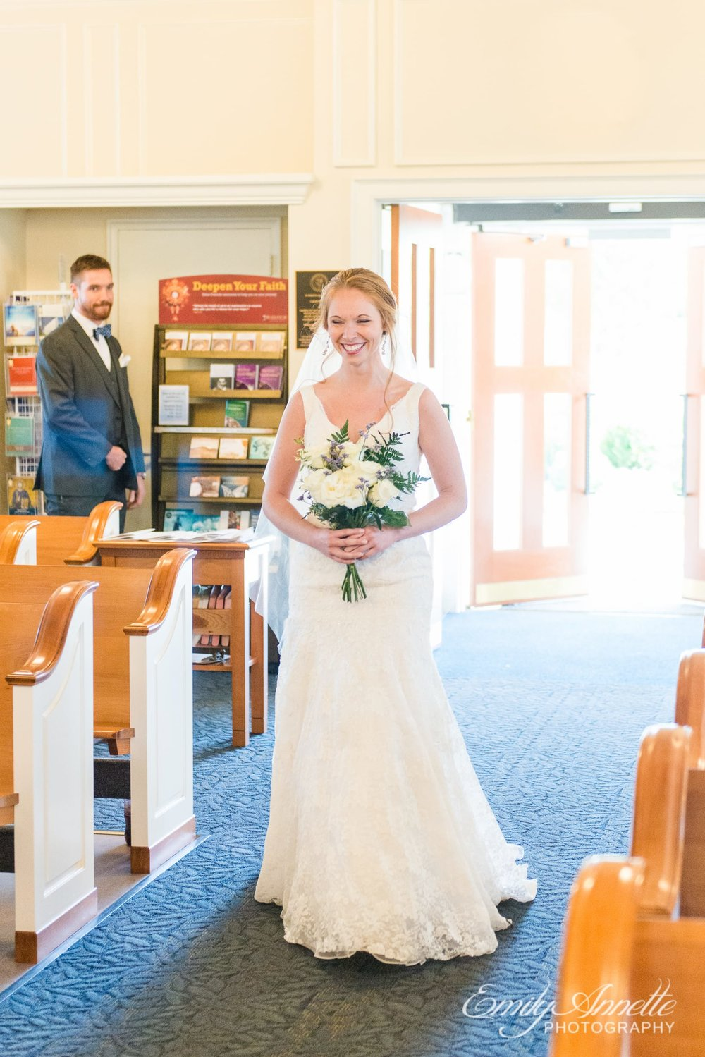 The bride enters for bridal procession during a Catholic wedding ceremony at Marymount University's Sacred Heart of Mary Chapel in Arlington, Virginia