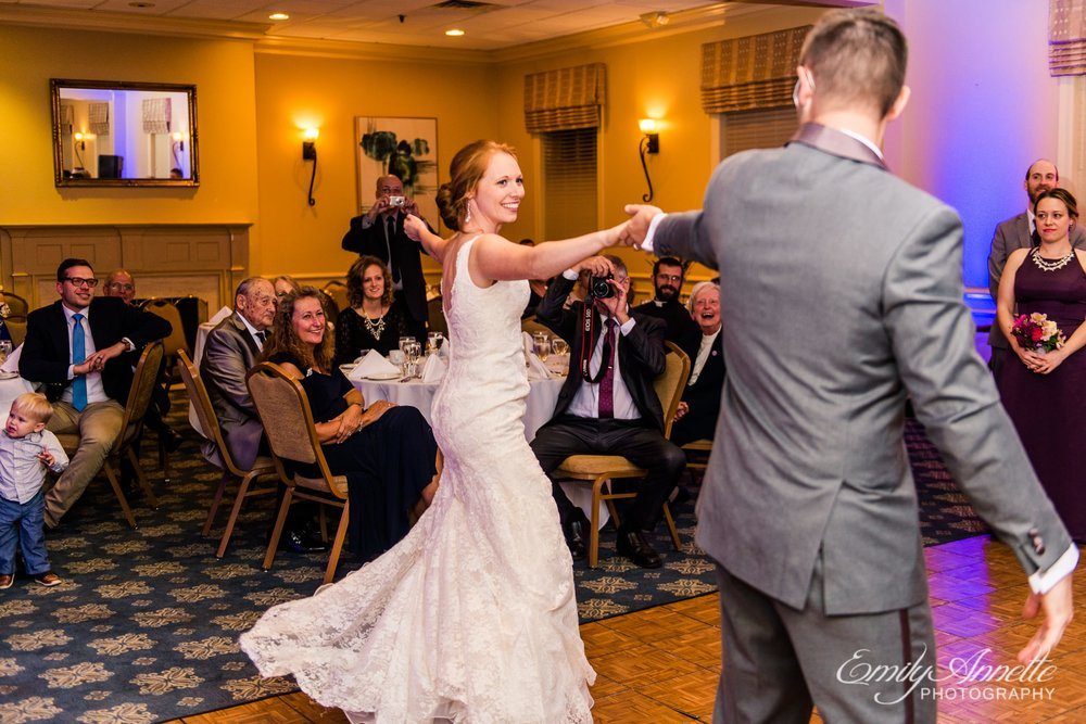 The bride and groom share their first dance in the classic ballroom at Holly Hills Country Club in Frederick, Maryland