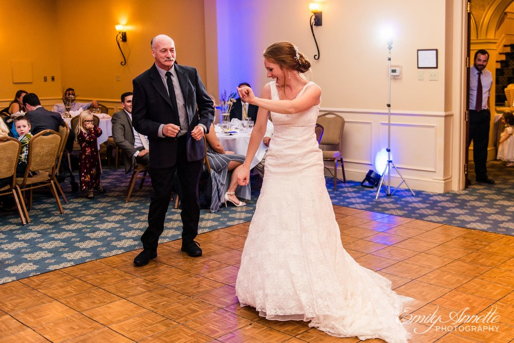 The bride and her father share a dance in the classic ballroom at Holly Hills Country Club in Frederick, Maryland