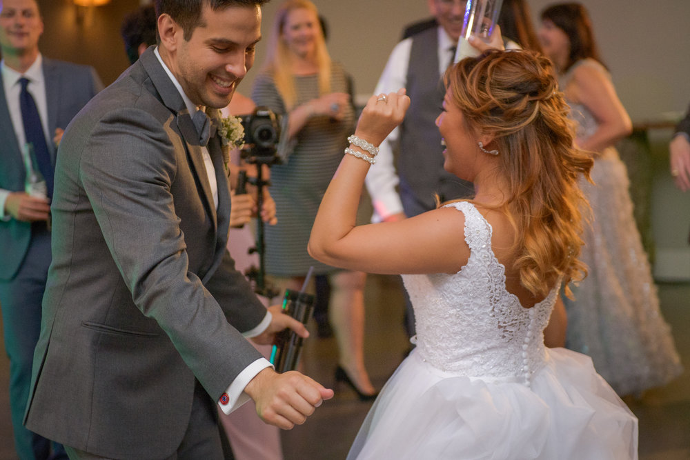 A bride and groom dance and smile at a reception at Blue Valley Vineyard and Winery in Delaplane, Virginia