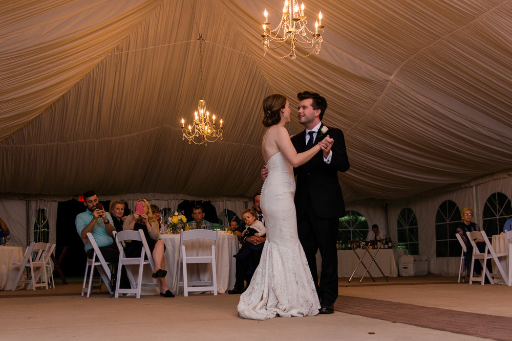The bride and groom share their first dance in a tented reception at Oatlands Historic House and Gardens in Leesburg, Virginia