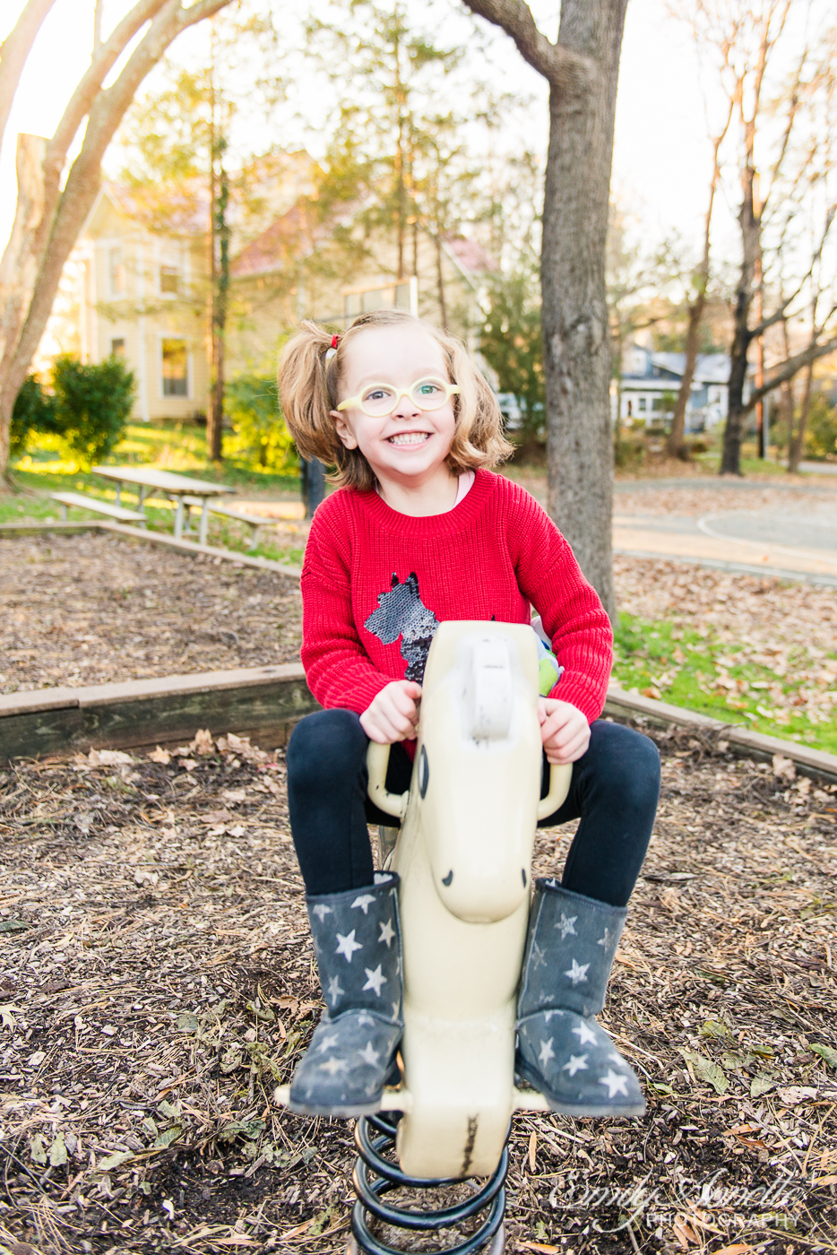 A young girl playing at Clifton Town Park in Fairfax County, Virginia